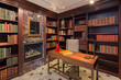 Amazing private Library with bookshelf, fire place and desk.