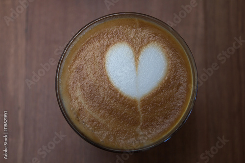 Foto op Plexiglas Cup of cappuccino art coffee with froth shape heart and wooden b