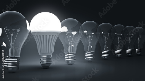 Photo  Glowing LED bulb and simple light bulbs. 3d rendering