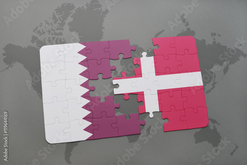 puzzle with the national flag of qatar and denmark on a world map background Poster