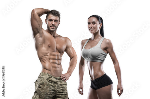 Sports man and woman posing in studio