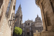 Cathedral rising up between the narrow streets of Toledo, Spain