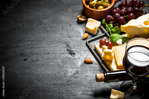 Fotografie, Obraz  Red wine with fragrant cheese , olives and almonds.