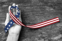 American Flag Pattern Awareness Ribbon On People's Hand Support