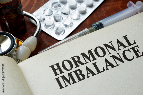 Book with words hormonal imbalance on a table. Fototapet