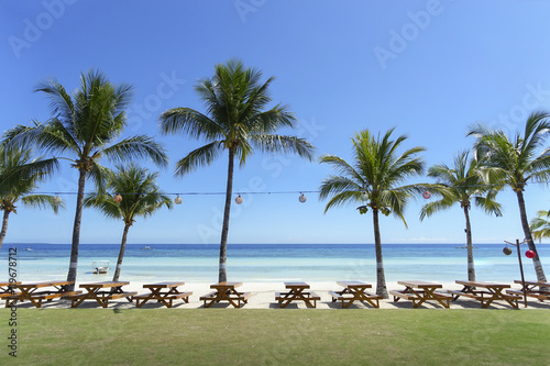 Resort Picnic Tabels and Coconut Trees Lining a White Sand Beach - Panglao, Boho Canvas Print