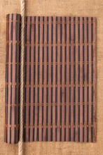 Bamboo Mat Rolled Into A Scroll And Rope, Lying On A Sacking