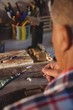 Goldsmith using hand piece machine