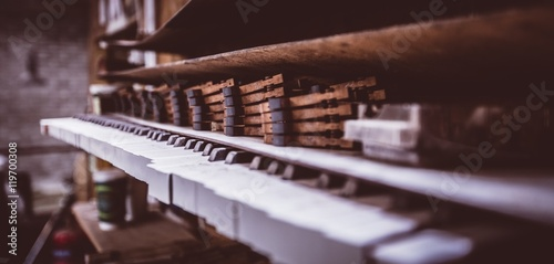 Close up of piano parts in workshop