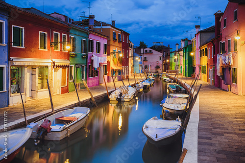 Colourfully painted houses facade on Burano island in evening, province of Venic Canvas