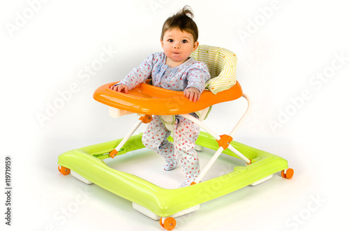 Photo  baby girl in a walker