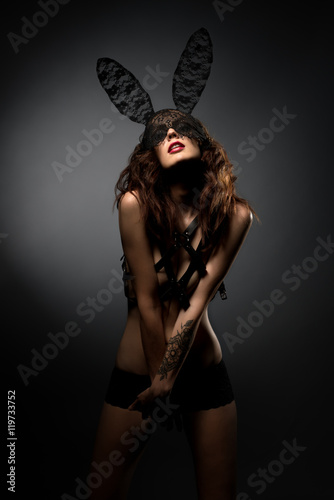 Poster  Photo of playful model posing in bunny ears mask