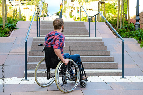 Fotografie, Obraz  disabled man in wheelchair in front of stairs