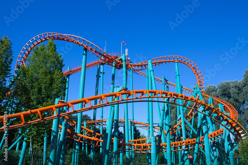 Papiers peints Attraction parc Orange rollercoaster with blue sky in the background