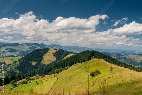 Fototapeta Beautiful mountain landscape. Blue sky, green meadows. obraz na płótnie