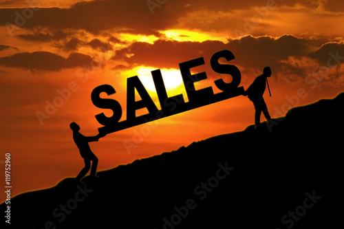 Fototapety, obrazy: Business team carrying sales word