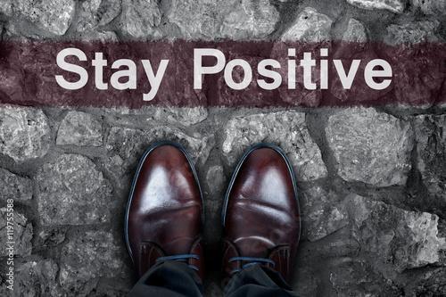 Photo  Stay positive message on asphalt