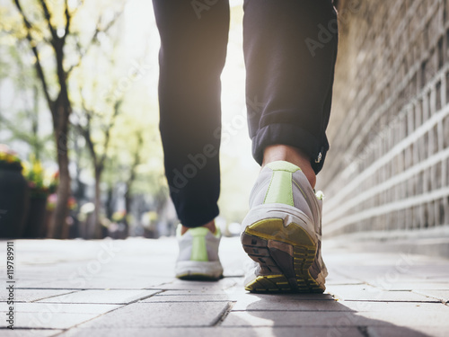 Fotografie, Obraz  Woman Walking outdoor Jogging exercise with Morning light Health