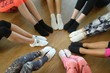Legs of athletes woman wearing sports shoes in a circle. Top view