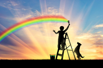 Child paints a rainbow in the sky
