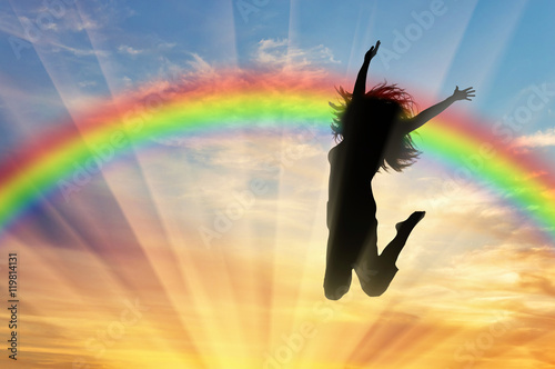 Fotografía  Happy woman jumping near rainbow