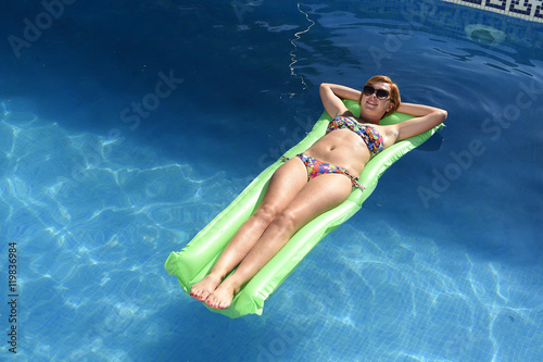 beautiful woman in bikini lying relax on float airbed at vacacti Canvas Print