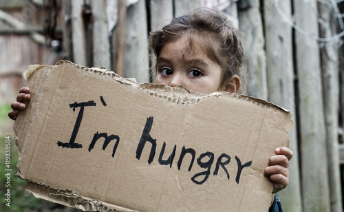 Little girl holding a sheet of cardboard Fotobehang