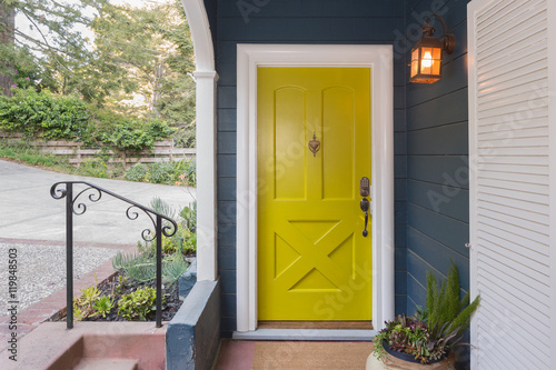 Fotografie, Obraz  Yellow Green Entry Door / Front Door with single cylinder entran