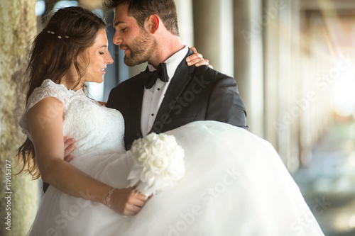 Romantic Beautiful Married Wedding Couple Groom Carries Bride In His Arms Embrace Buy This Stock Photo And Explore Similar Images At Adobe Stock Adobe Stock