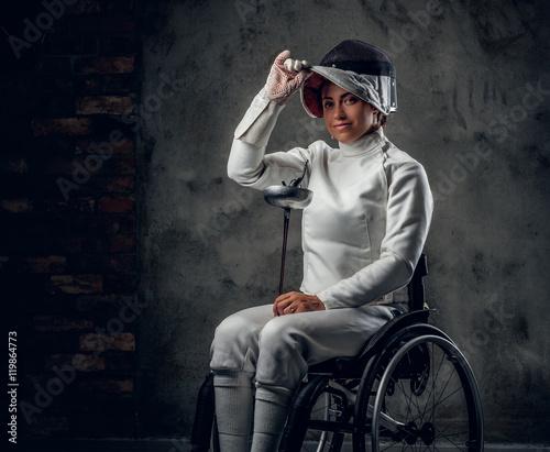 Valokuva  Female paralympic wheelchair fencer.