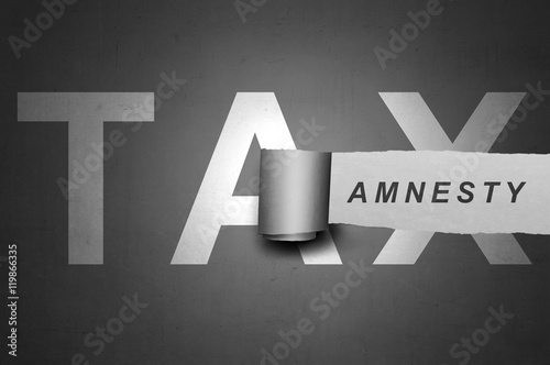 Photo Tax amnesty quotes design on the gray board