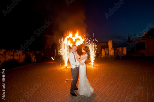 Wonderful fire show for happy wedding couple Wallpaper Mural