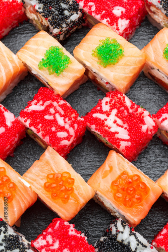 Sushi roll set on a stone plate. Japanese cuisine. - 119886987