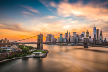 New York City Skyline Over The Brooklyn Bridge.