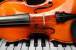 Leinwanddruck Bild - Violin and piano, closeup