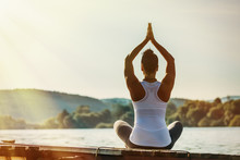 Young Woman Doing Yoga In Morning