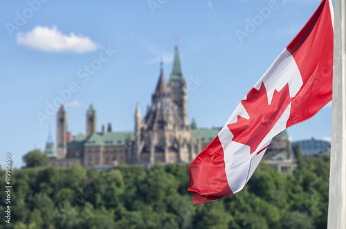 Poster Canada Canadian flag waving with Parliament Buildings hill and Library