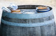 Ashtrays On Wooden Barrel In Tuscany