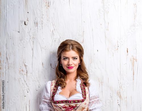 Tableau sur Toile Beautiful woman in traditional bavarian dress, studio shot