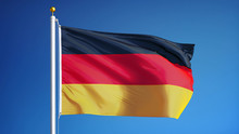 Germany Flag Waving Against Clean Blue Sky, Close Up, Isolated With Clipping Path Mask Alpha Channel Transparency