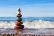 Concept of harmony and balance. Rock Zen near the sea