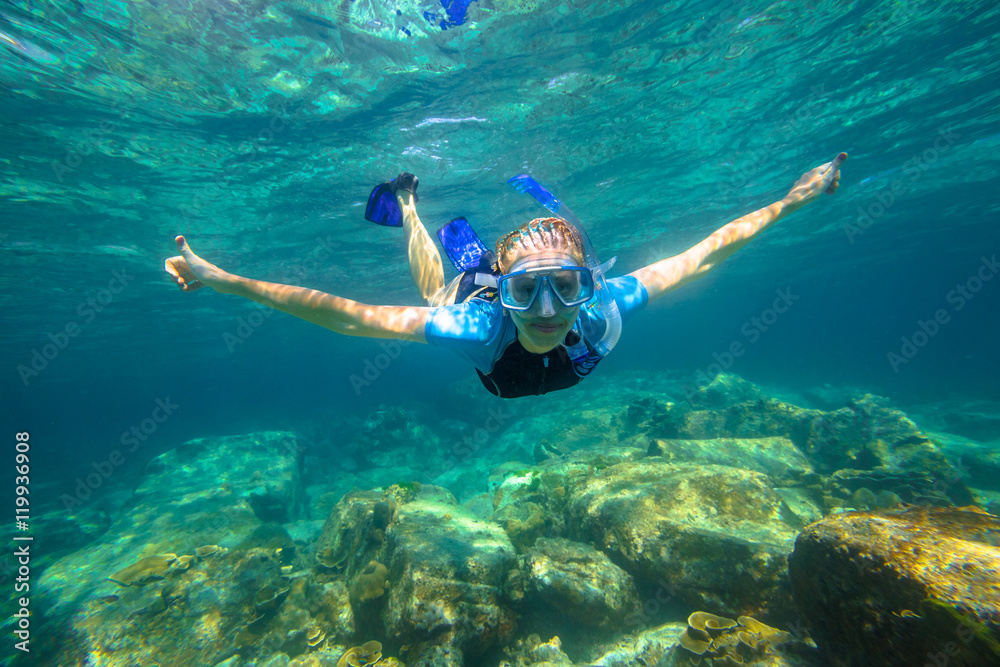 Photo & Art Print Female apnea swims in tropical turquoise sea of
