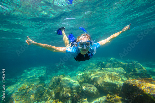 Foto op Plexiglas Duiken Female apnea swims in tropical turquoise sea of Racha Noi, Phuket in Thailand.