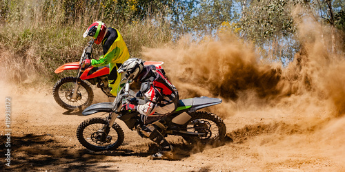 Photo sur Aluminium Motorise Motocross riders race around a corner
