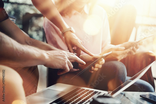 Young Coworkers Team Analyze Meeting Report Electronic Gadgets.Businessmans Startup Online Marketing Project.Creative People Making Great Work Decisions Office.Tablet Laptop.Closeup Blurred Background