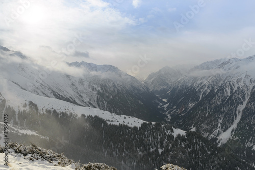 Fotografie, Obraz  Snow mountains on a cloudy day