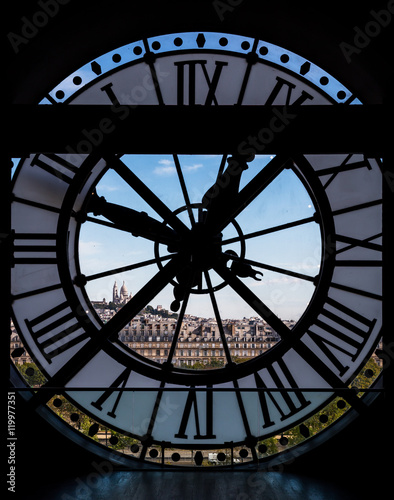 Poster Paris View through d'orsay museum clock tower of Sacre-Coeur Basilica.
