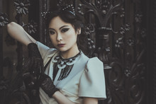Asian Fashion Model With Cat Ears Over Black Hair