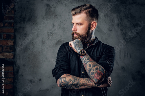 Fototapeta Bearded hipster with tattooe on his arms. obraz