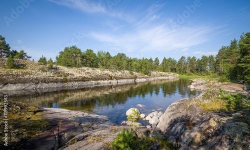 Photo  Small bay between the rocky shores of Karelian islands.